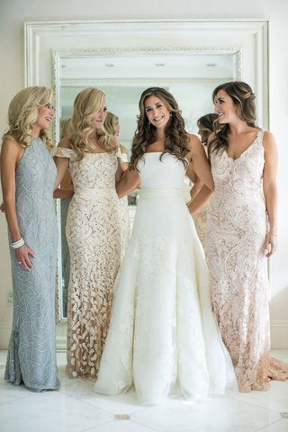 mother-of-bride-in-light-blue-halter-neckline-dress-pretty-curled-hair-bride-in-vera-wang-gown