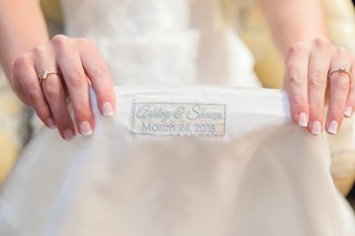 pale-blue-embroidery-of-names-and-wedding-date-on-lining-of-wedding-dress