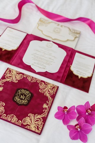 chic-wedding-invite-velvet-book-gold-details-monogram-red-burgundy-fuchsia