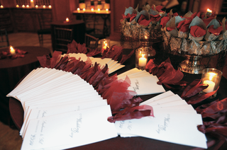display-of-white-and-red-wedding-programs-and-wedding-petal-toss-cones