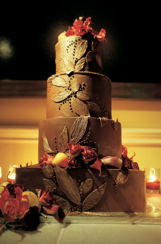 four-layer-cake-with-red-roses-and-brown-frosting
