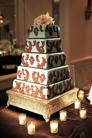 five-layer-cake-on-gold-platter-with-candles