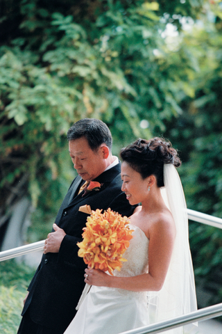 bride-in-a-strapless-dress-with-father-in-a-black-tuxedo