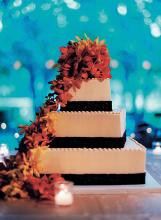 wedding-cake-with-brown-bands-and-orange-and-yellow-flowers