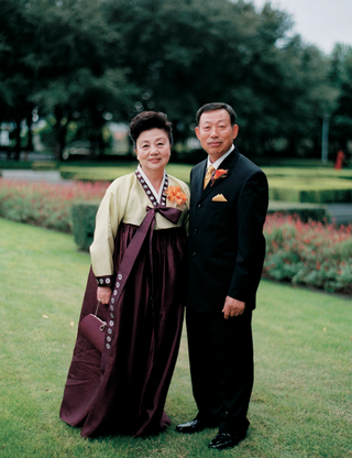 mother-in-traditional-korean-dress-and-father-in-a-black-tuxedo