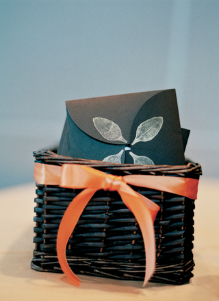 black-wedding-programs-decorated-with-white-leaves