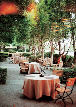 tables-covered-in-light-orange-tablecloths-for-a-wedding-cocktail-hour-at-marie-gabrielles-patio