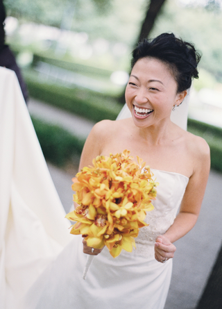 bride-in-a-strapless-dress-with-a-bouquet-of-yellow-flowers