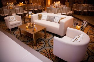 couch-and-chairs-next-to-white-dance-floor