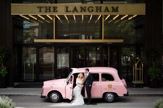 bride-and-groom-with-classic-pink-car-for-the-langham-chicago-vehicle