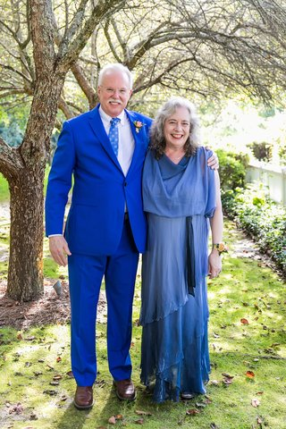 wedding-portrait-father-of-groom-in-azure-blue-suit-and-tie-mother-of-groom-in-blue-gown-woods
