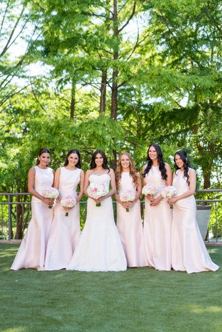 bride-in-monique-lhuillier-wedding-dress-with-bridesmaids-in-pink-high-neck-floor-length-gowns