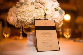 wedding-invitation-in-tan-gold-with-a-black-ribbon