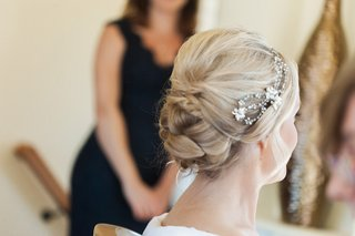 brides-updo-hairstyle-with-sparkling-headband-headpiece-with-flowers