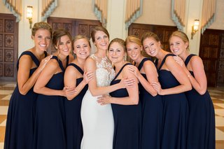 bride-in-pronovias-atelier-wedding-dress-bridesmaids-in-amsale-navy-bridesmaid-dresses