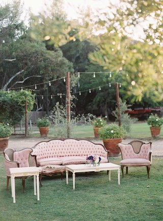 french-vintage-theme-wedding-with-light-pink-antique-furniture-and-coffee-table-at-outdoor-wedding