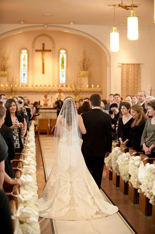 bride-in-a-veil-and-strapless-dress-with-beading-and-lace-details-walking-down-the-aisle-with-father