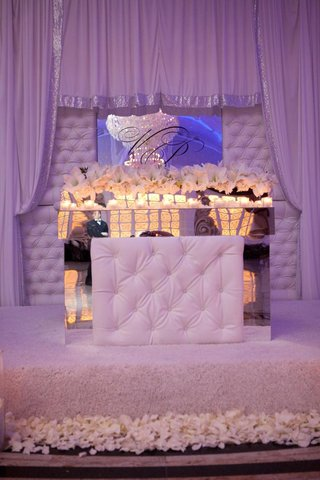 wedding-reception-with-fabric-draped-alcove-for-bride-and-groom