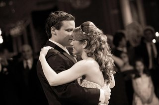 black-and-white-photo-of-bride-and-groom-dancing