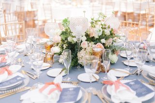 wedding-reception-round-table-blue-linen-low-short-centerpiece-candles-pink-peach-accent-color