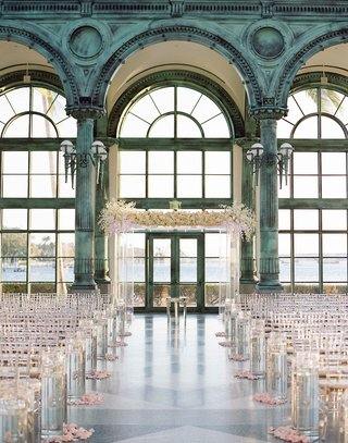henry-morrison-flagler-museum-wedding-ceremony-lucite-chairs-and-arch-white-pink-flower-petals