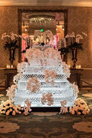 wedding-anniversary-party-ice-sculpture-in-shape-of-cake-with-fresh-flower-decorations-and-50-cake-t