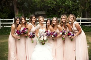 bride-with-bridesmaids-outside-in-malibu-california
