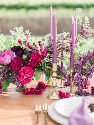 vibrant-arrangement-blossoms-candles-purple-california-boho-chic-wedding-styled-shoot-reception