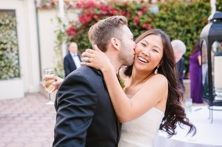 couple-embraces-bride-and-groom-at-bel-air-bay-club-wedding