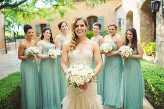 bride-in-strapless-liancarlo-mermaid-wedding-dress-with-bridesmaids-in-mismatched-mint-green-gowns