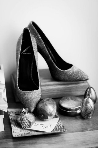 black-and-white-photo-of-brides-sparkly-heels-on-wood-stand-love-you-note