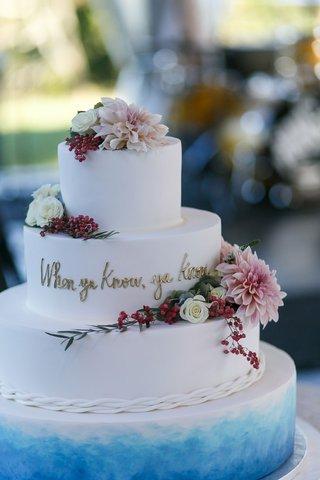 four-layer-wedding-cake-with-blue-bottom-layer-when-ya-know-ya-know-gold-writing-fresh-flowers