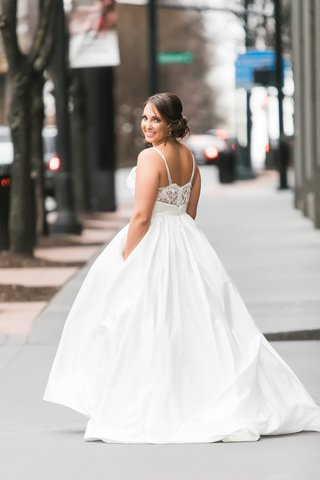 bride-in-modern-trousseau-ball-gown-with-lace-back-spaghetti-straps-and-pockets