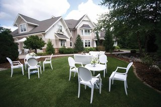white-round-back-chairs-and-tables-on-front-lawn