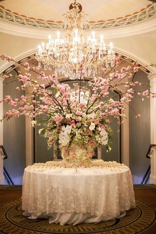 the-pierre-wedding-escort-card-table-with-pink-branch-arrangement