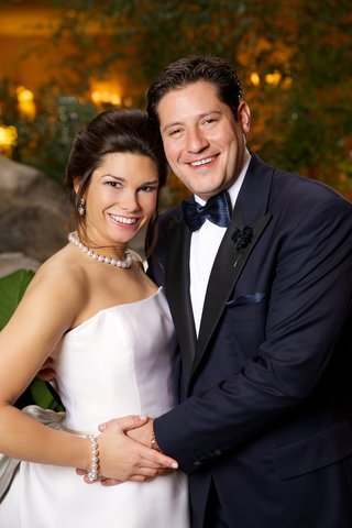 bride-with-pearl-earrings-necklace-and-bracelet-with-groom-in-midnight-blue-tuxedo