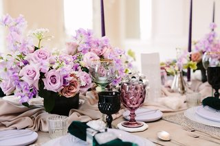 wedding-inspiration-styled-shoot-colored-goblets-dark-green-maroon-lavender-flowers