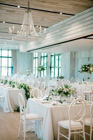 wedding-reception-decor-white-lace-linen-greenery-white-flowers-wood-ballroom-black-windows