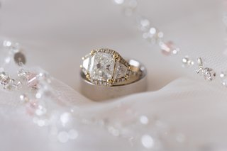 radiant-diamond-with-trapezoid-side-stones-yellow-gold-pave-halo-around-all-three