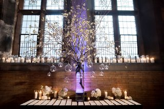 wedding-reception-historic-hall-hotel-cherry-blossom-flower-arrangement-tea-lights-candles-glass