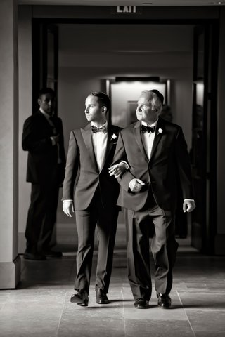 black-and-white-photo-of-groom-in-ralph-lauren-black-label-walking-with-his-father