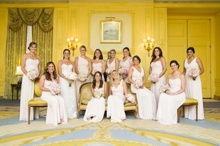 bridesmaids-in-hotel-ballroom-with-pink-floor-length-dresses