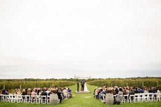 green-vineyard-wedding-ceremony-vines-white-chairs-chuppah-jewish-ceremony