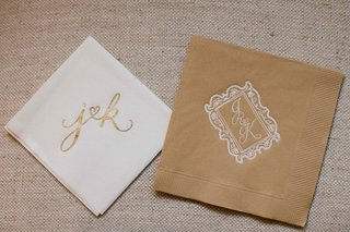 fun-modern-calligraphy-gold-and-white-cocktail-napkin-and-sophisticated-monogram-on-tan-napkin
