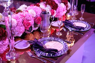 wedding-reception-place-setting-pink-red-hydrangea-rose-flowers-crystal-napkin-ring-and-plate-mirror
