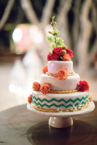 colorful-three-tier-wedding-cake-florals-wave-patterns-gold-blue-orange-red-green-mexico-destination