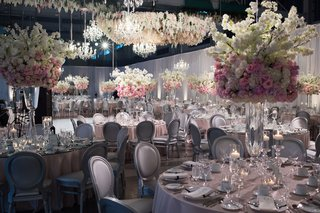 wedding-reception-with-silver-chairs-and-pink-linen-tables-round-tall-centerpieces-pink-flowers