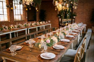 wedding-reception-rustic-chic-rose-gold-copper-low-flower-arrangements-flower-chandelier-wood-tables