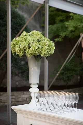 green-flower-arrangement-southern-inspired-wedding-champagne-glasses-bar