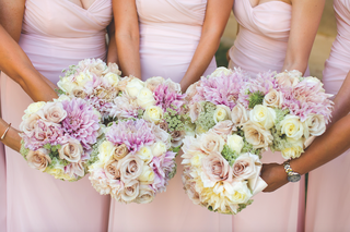 bridesmaids-holding-their-nosegays-together-in-a-circle